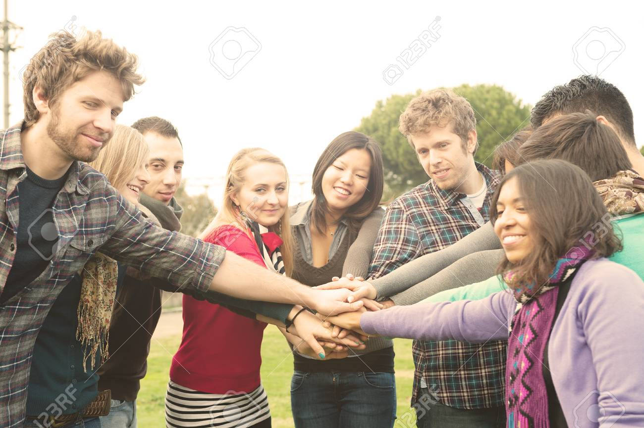 a group of multiracial students whit hands on stack Stock Photo - 11510998
