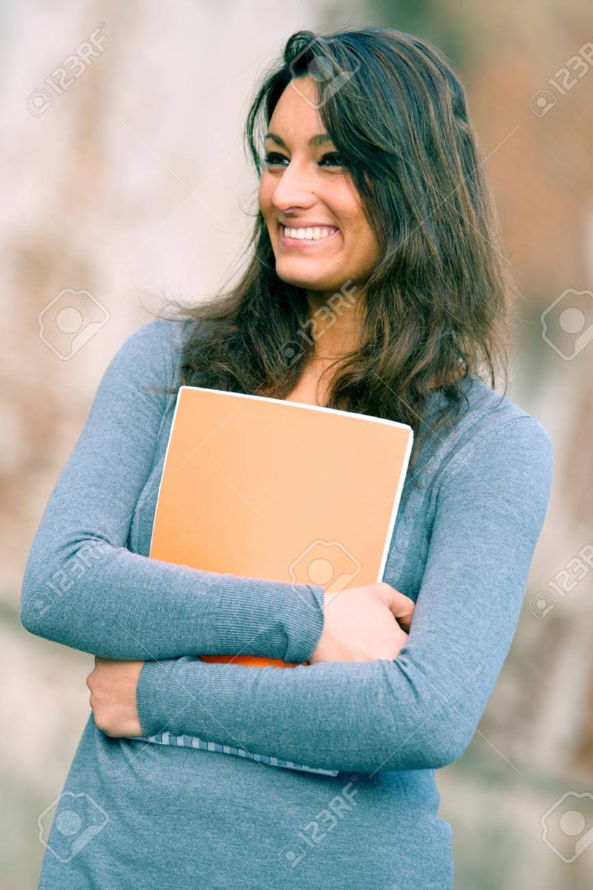 Portrait of  young ,brunette,woman student in the park,Pisa Italy Stock Photo - 13166437