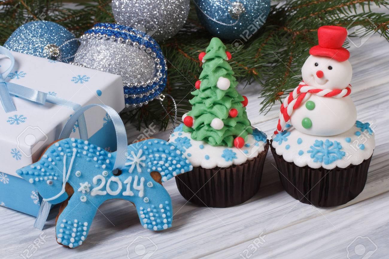 Christmas cake and symbol 2014 blue horse Stock Photo - 24037446