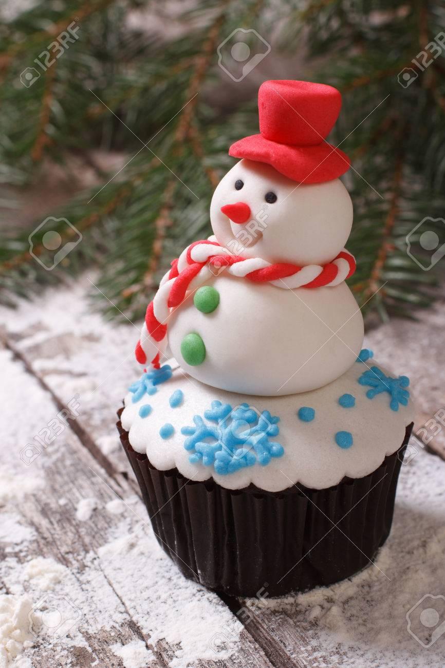 Cupcake Christmas snowman on snow  vertical Stock Photo - 24037618