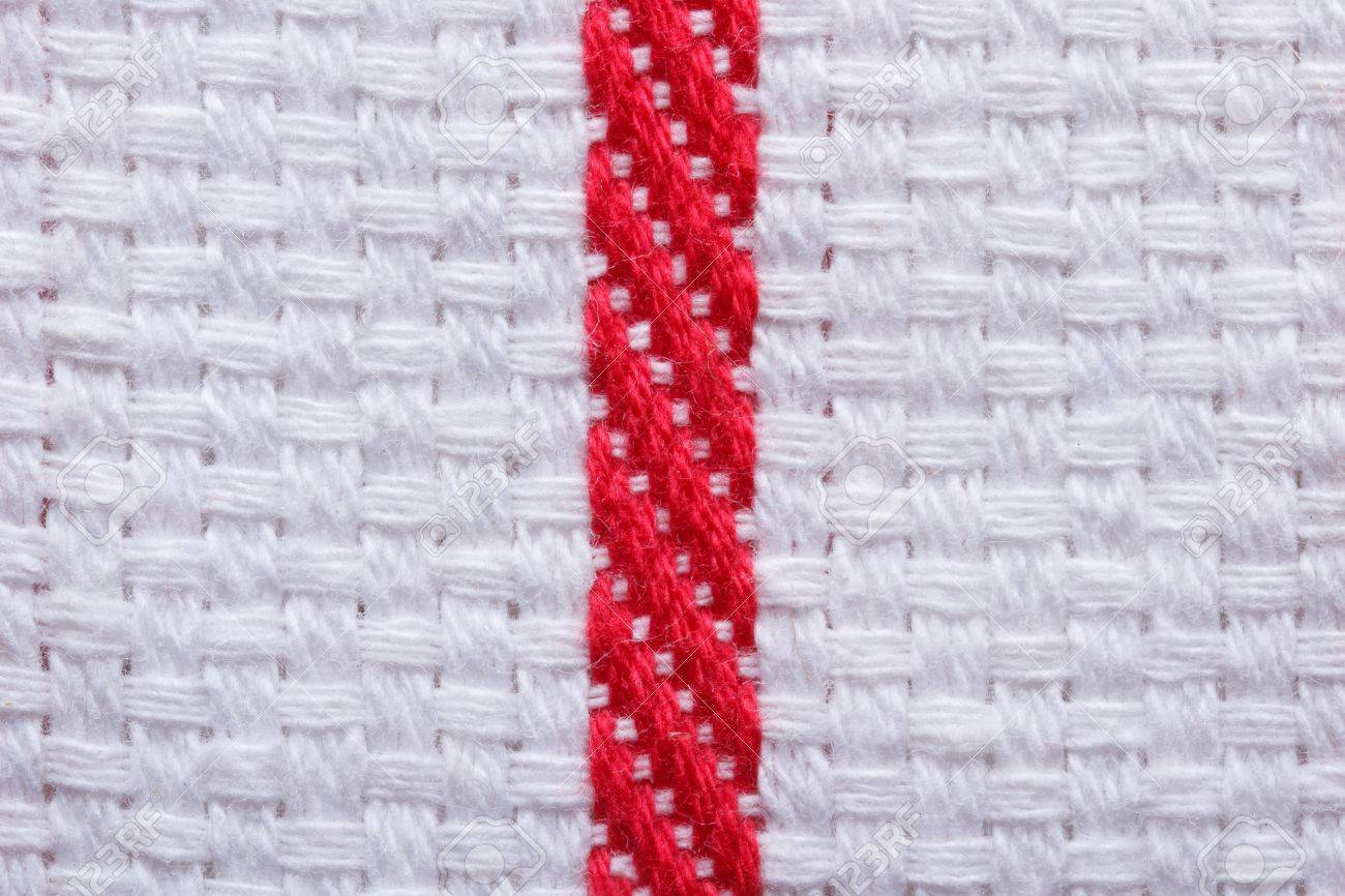 Texture of white cotton kitchen towel with a red stripe