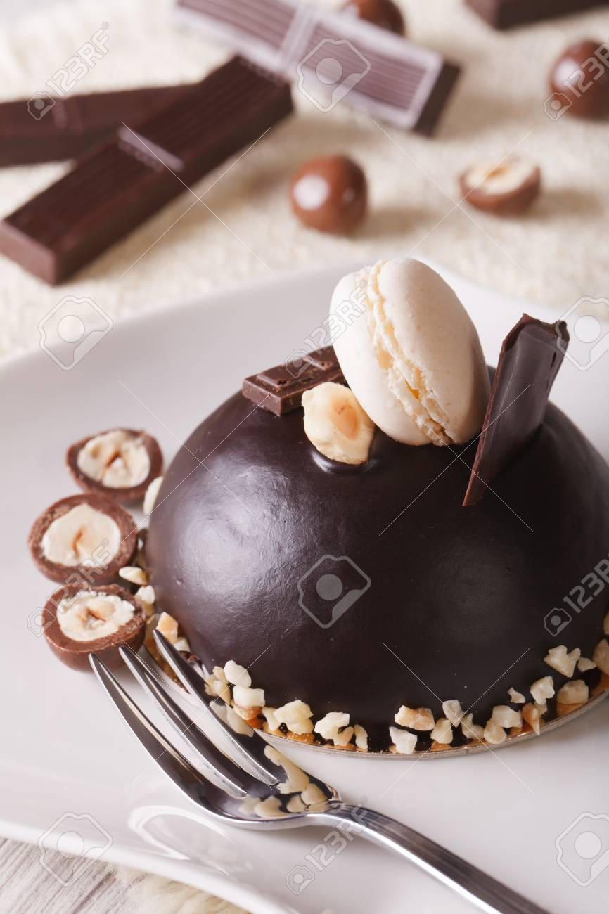 Beautiful Chocolate Cake With Nuts Topped With Macaroon On A