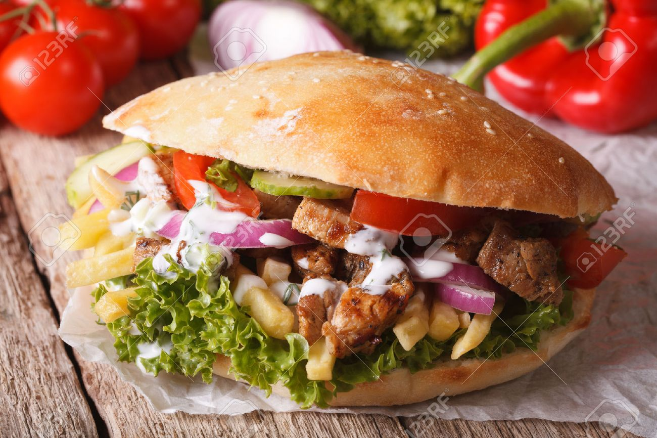 appetizing sandwich doner kebab with meat vegetables and french