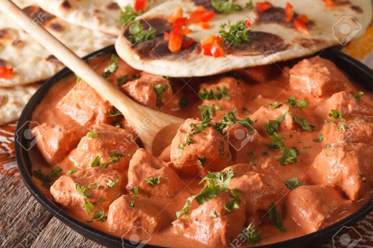 Indian food chicken tikka masala and naan close up on the table indian food chicken tikka masala and naan close up on the table stock photo forumfinder Choice Image