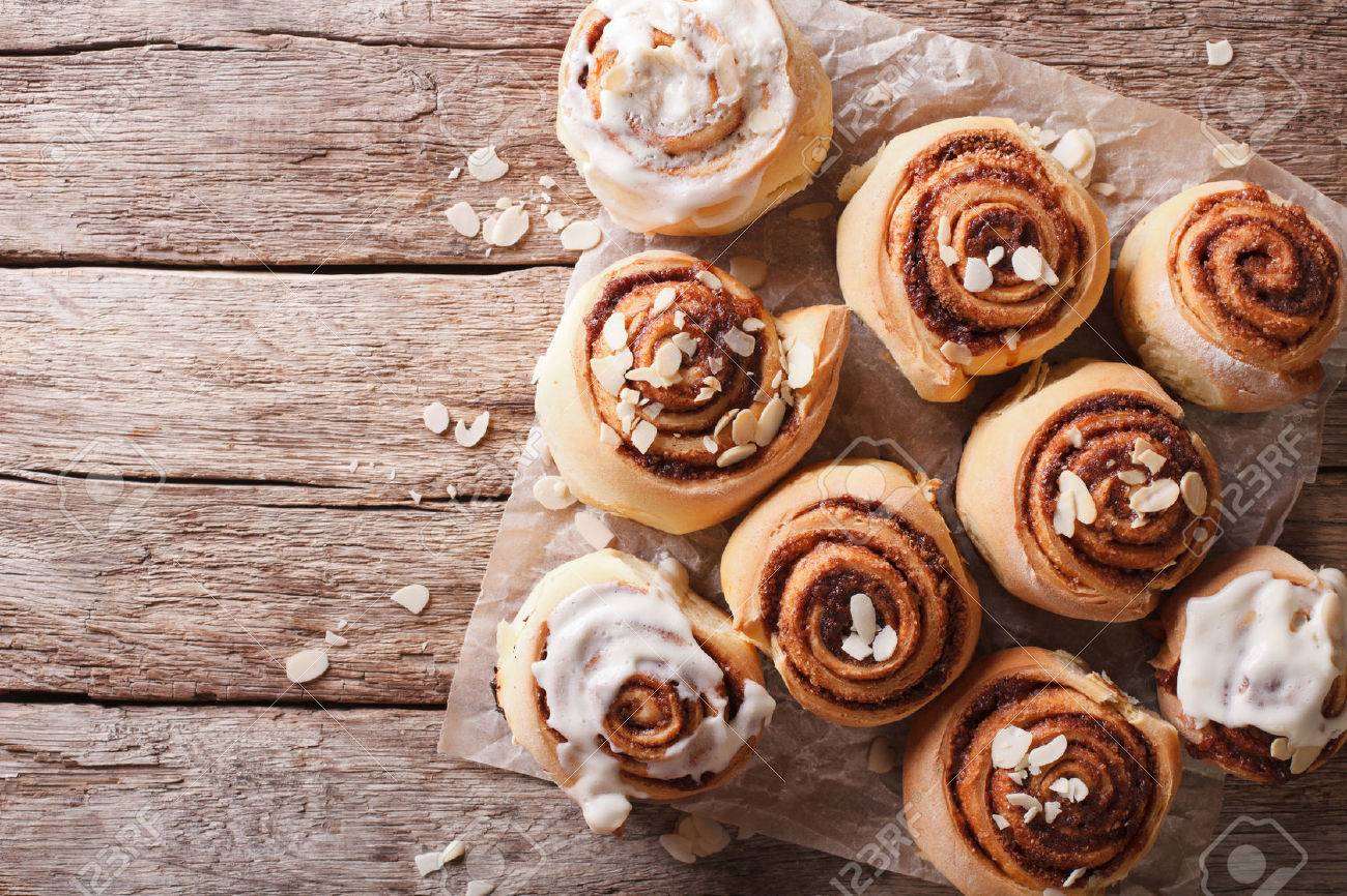 Cinnamon rolls with almond on the table. horizontal top view - 50903628