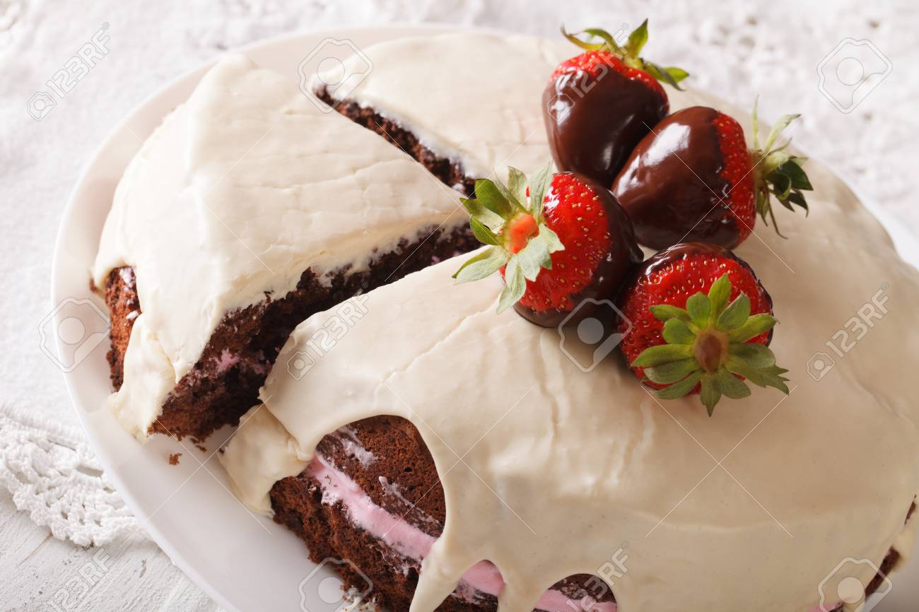 Beautiful Chocolate Cake With White Icing And Strawberries Close Up