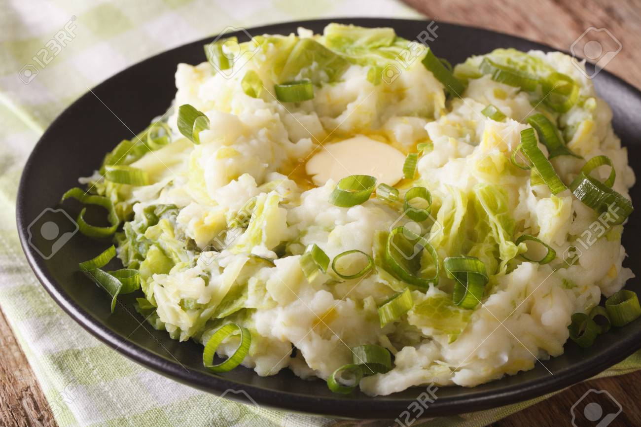 Irish colcannon - mashed potatoes with savoy cabbage and butter closeup on the table. horizontal - 62706793