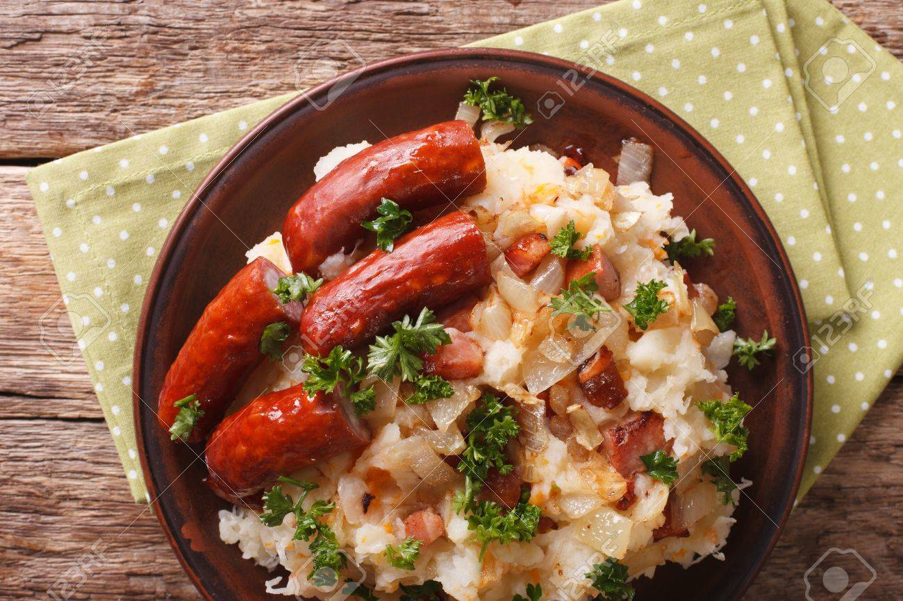 Stamppot Mashed Potatoes Cabbage And Carrots With Sausages Close Up On A Plate