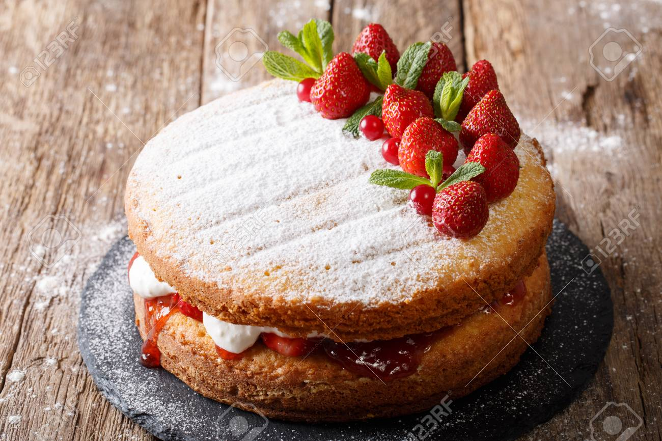 Home Victoria Sponge Cake Decorated With Strawberries Cranberries