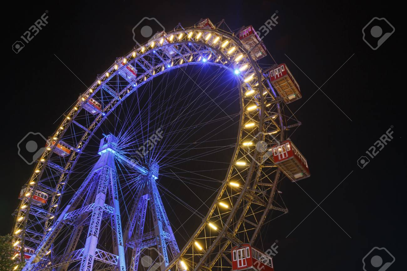 Lighting Ferris wheel at night in famous Prater theme amusement Park, Vienna. Austria - 82914371