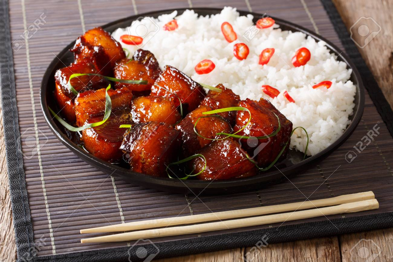 Vietnamese spicy caramel pork belly with rice closeup on a plate on a table. horizontal - 89371707