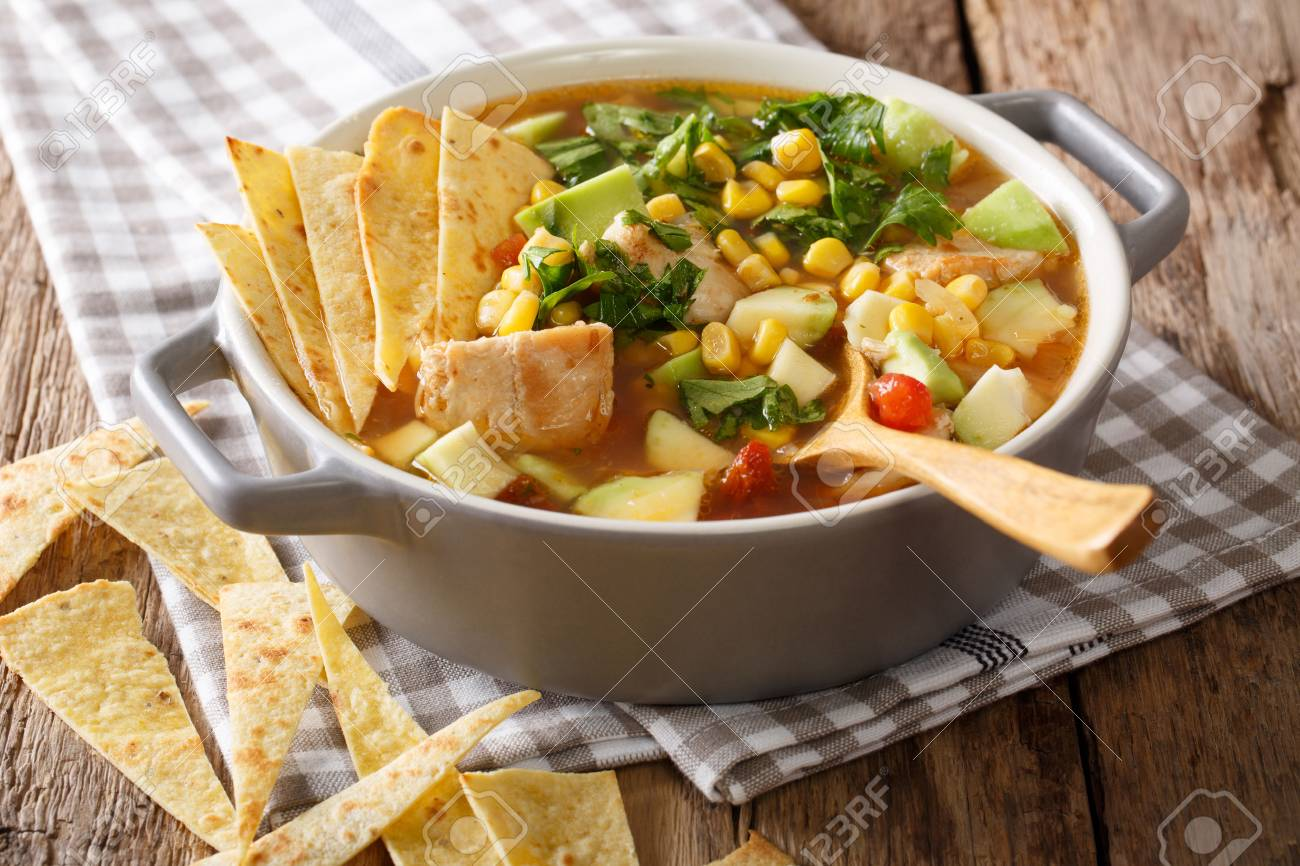 Freshly cooked tortilla soup with chicken and vegetables close-up on the table. horizontal - 89371773