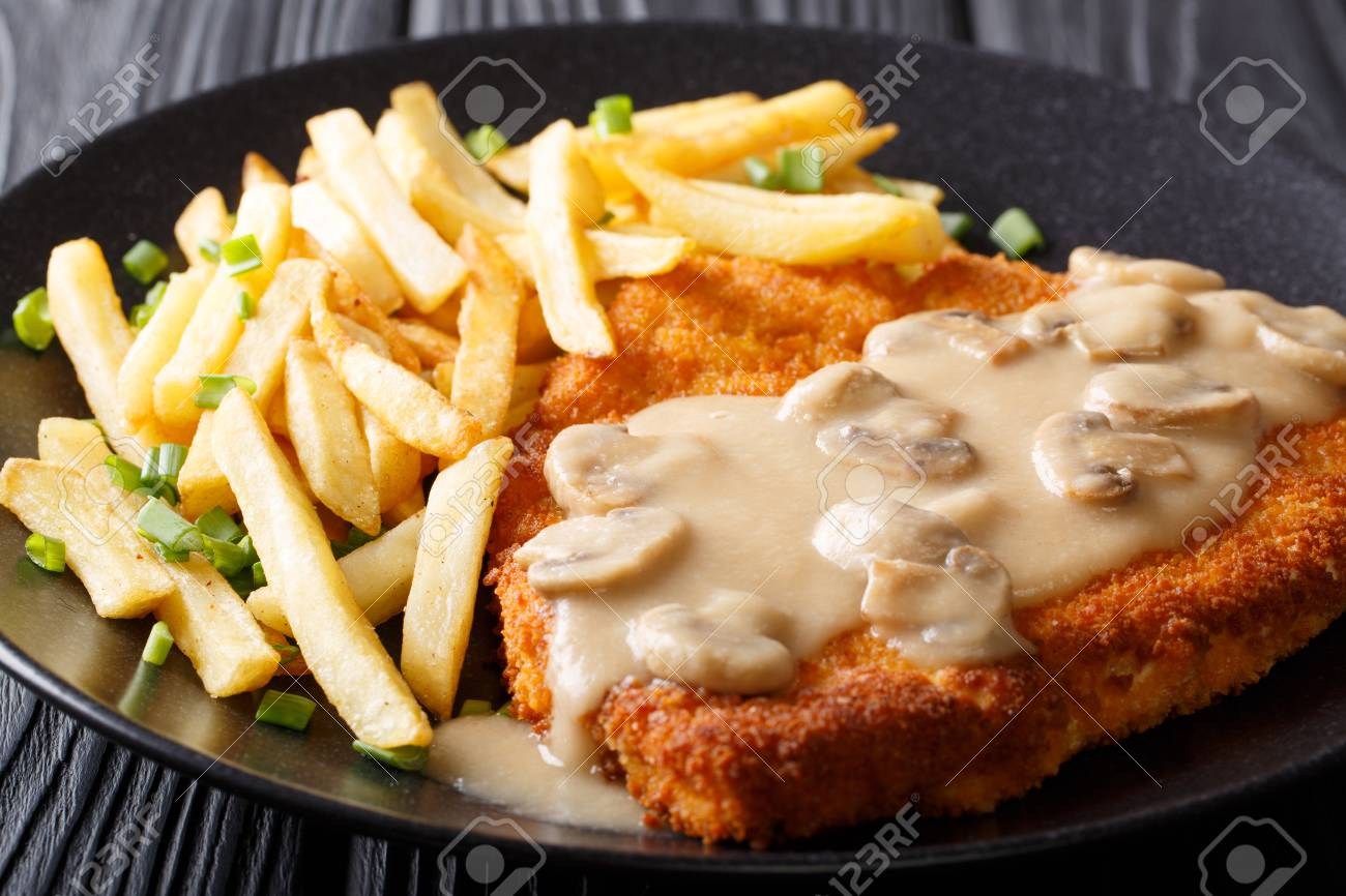 delicious Wiener Hunter schnitzel with sauce and french fries close-up on a plate. horizontal - 97046523