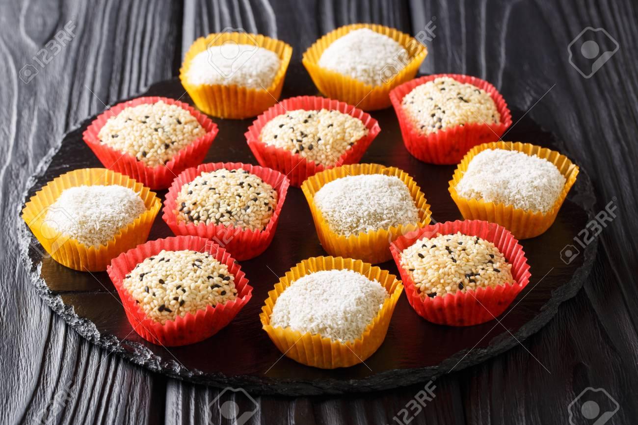Japanese mochi rice cake. Stuffed with sweet bean jam on slate..