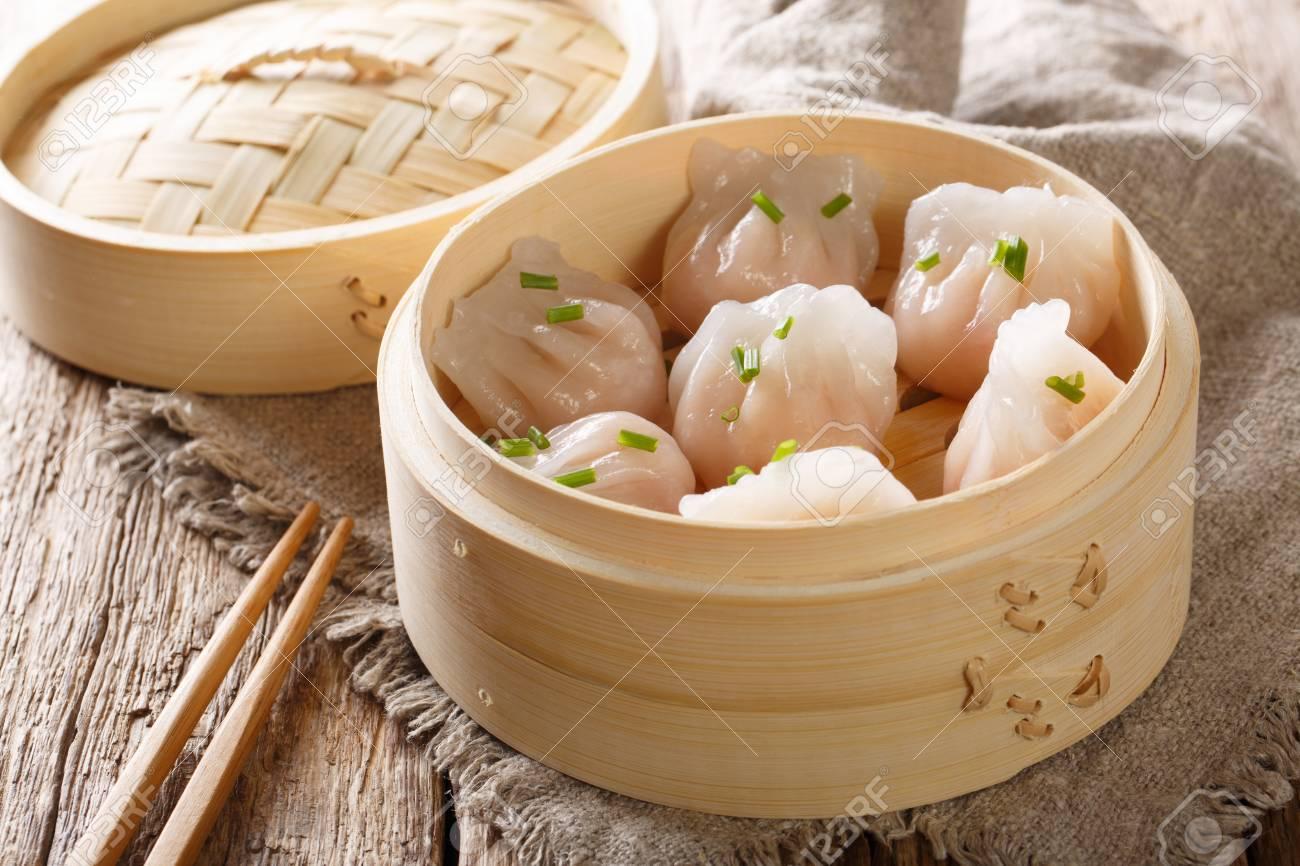 Steamed shrimp dumplings dim sum close-up on the table. horizontal - 115195602