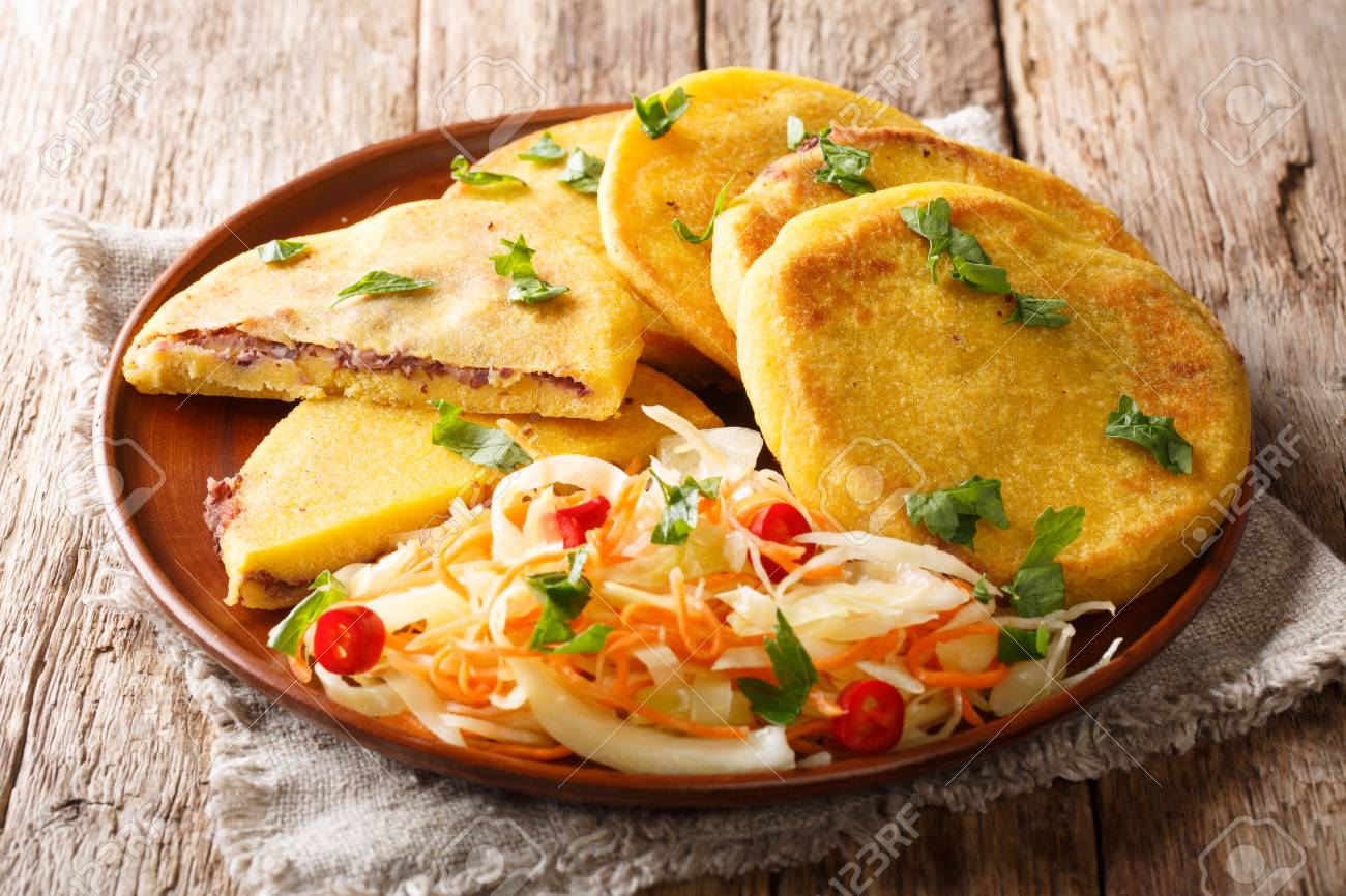 Tasty vegetarian pupusas recipe served with curtido closeup on a plate on the table. horizontal - 121862700