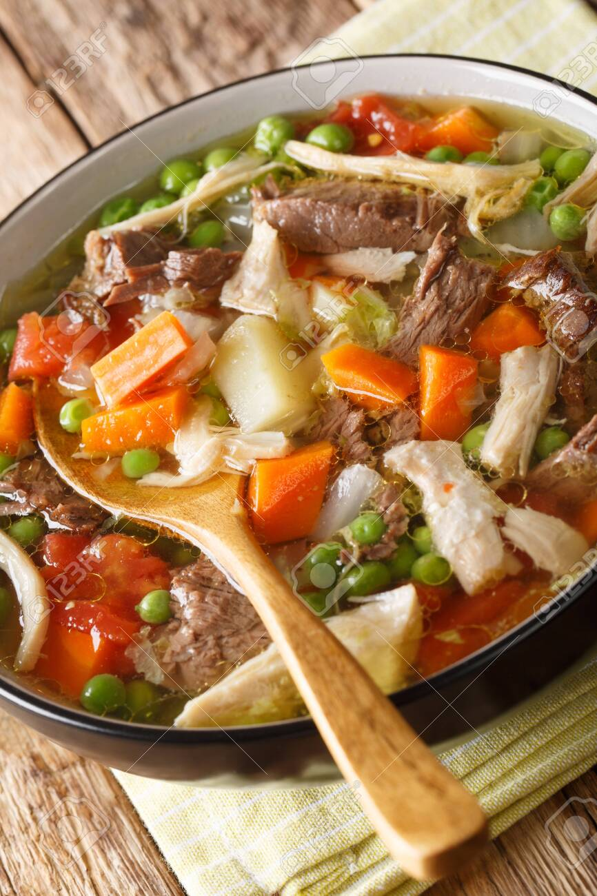 Slow Cooker Belgian Booyah soup with vegetables and meat close-up in a bowl on the table. - 131144611