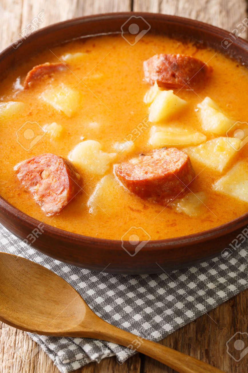 Hungarian Krumplileves potato soup with sausages close-up in a plate on the table. Vertical - 159822177