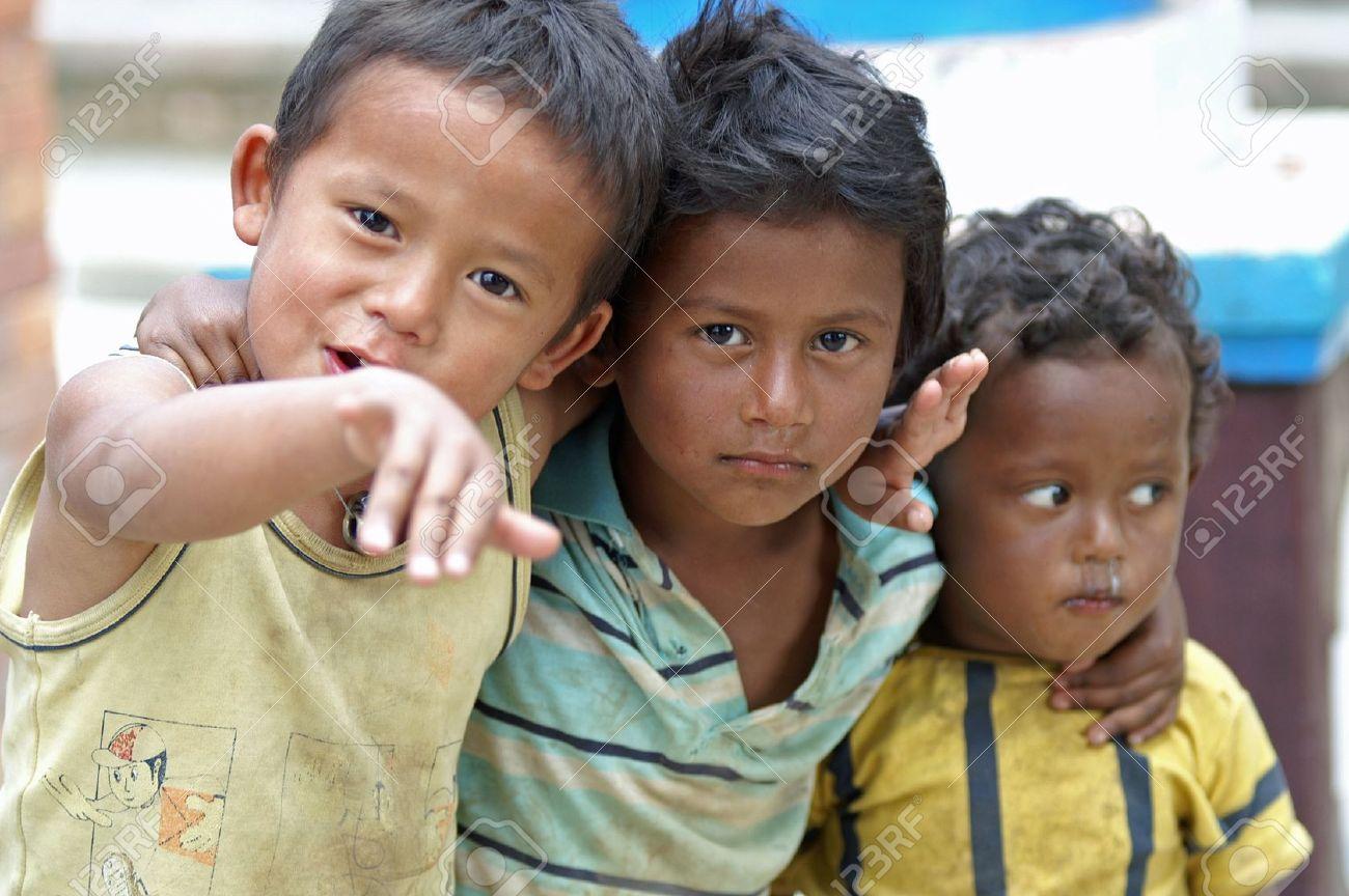 Kathmandu, Nepal, october 11, 2010: three children playing on the street Stock Photo - 10105024