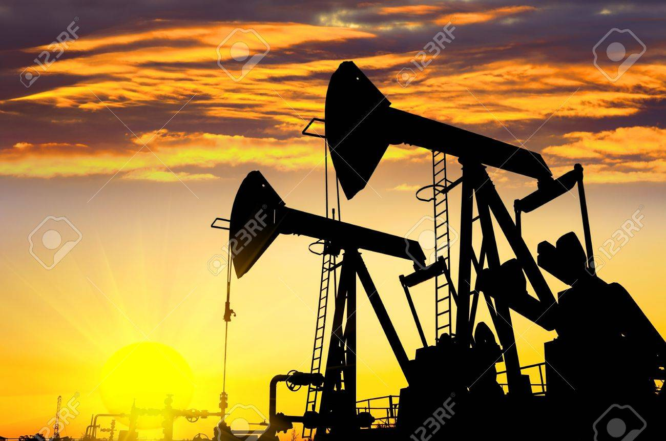 Silhouettes of oil pumps at dawn sky background Stock Photo - 15474356