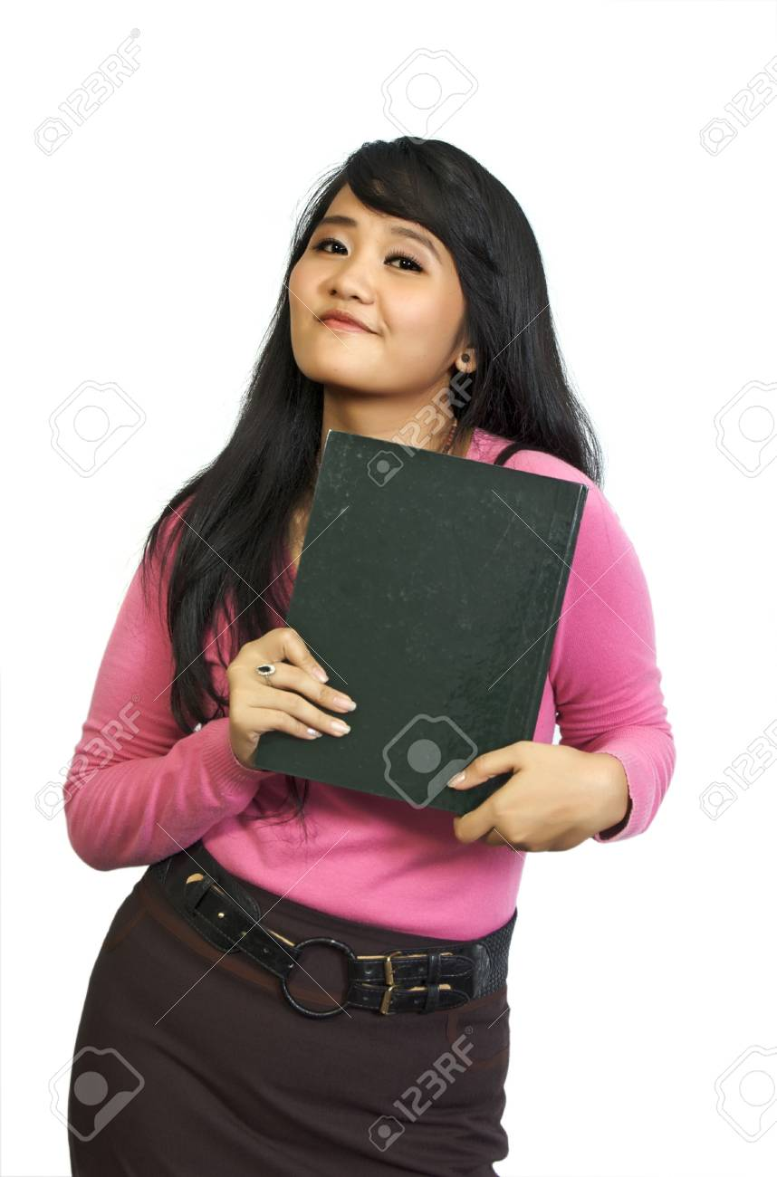 Beautiful college student holding book in her hand. She looks happy and intelligent Stock Photo - 5841356