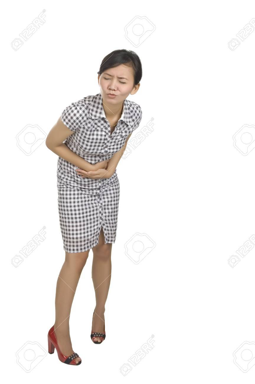 Young woman got stomach ache isolated on white background Stock Photo - 6309515