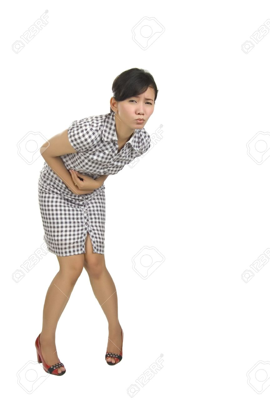 Young woman got stomach ache isolated on white background Stock Photo - 6309533