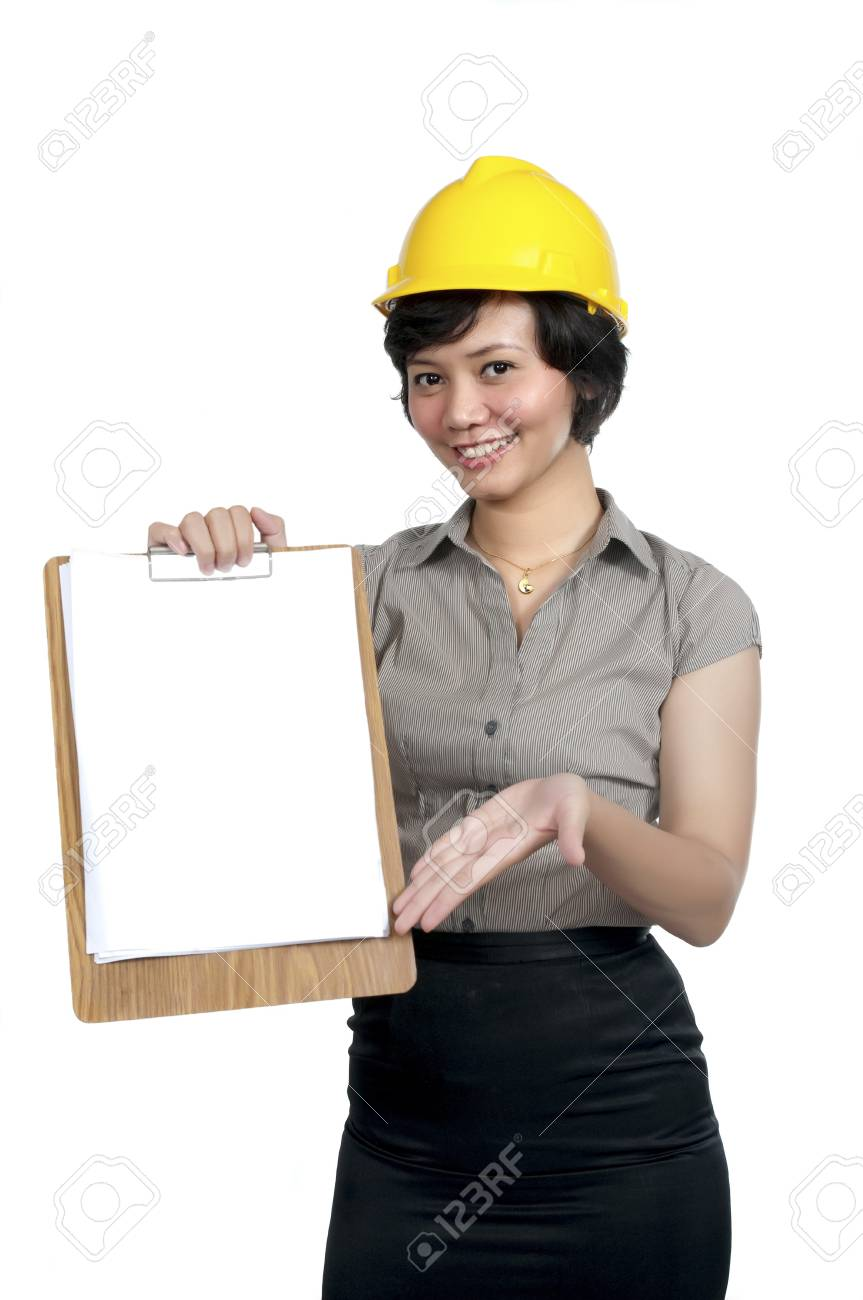 Female Engineer wearing yellow helmet show her paper board isolated over white background. You can put your text on the paper Stock Photo - 8253699