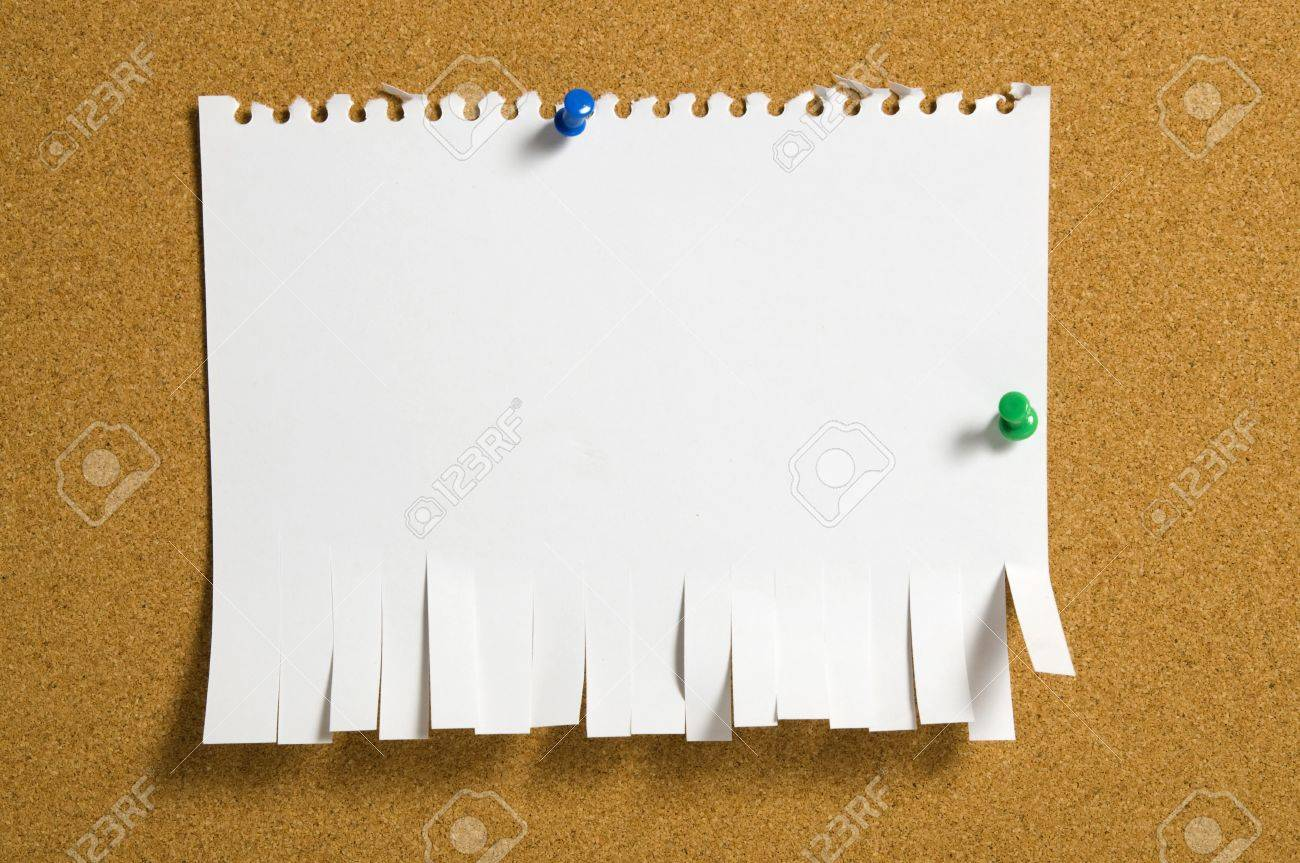 Torn Paper attached by push pin on the corkboard. You can put your message on the paper Stock Photo - 10254018