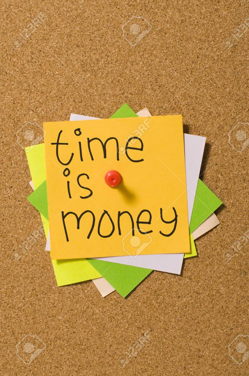 Time is money writing on the paper attached on the cork board Stock Photo - 10313102