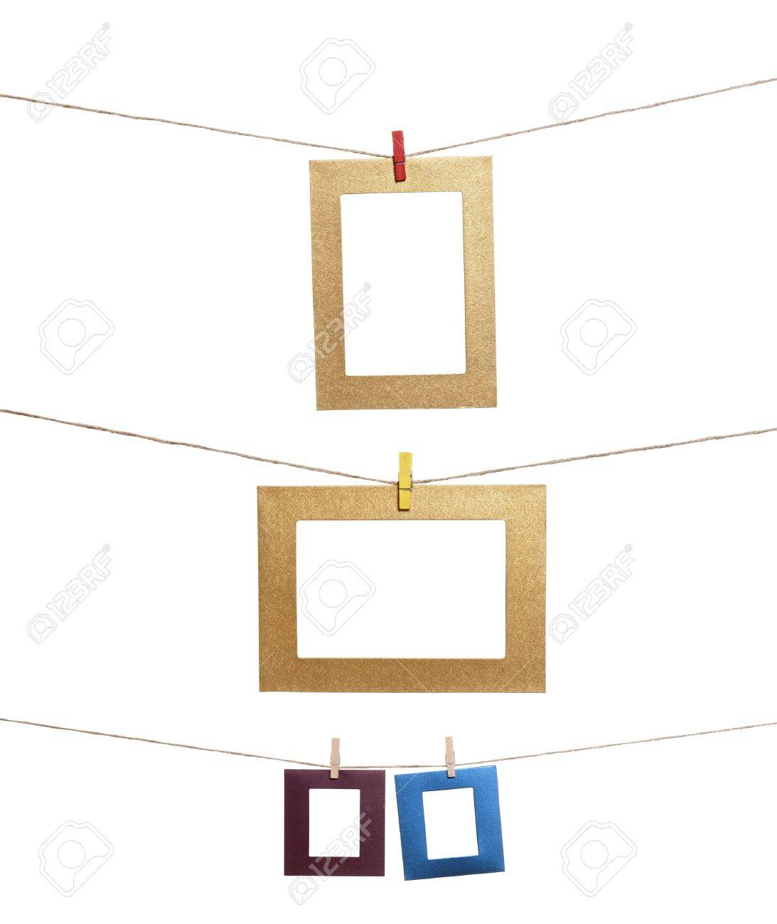 collection of blank photo frames hanging by clothespins on a rope stock photo 14774116