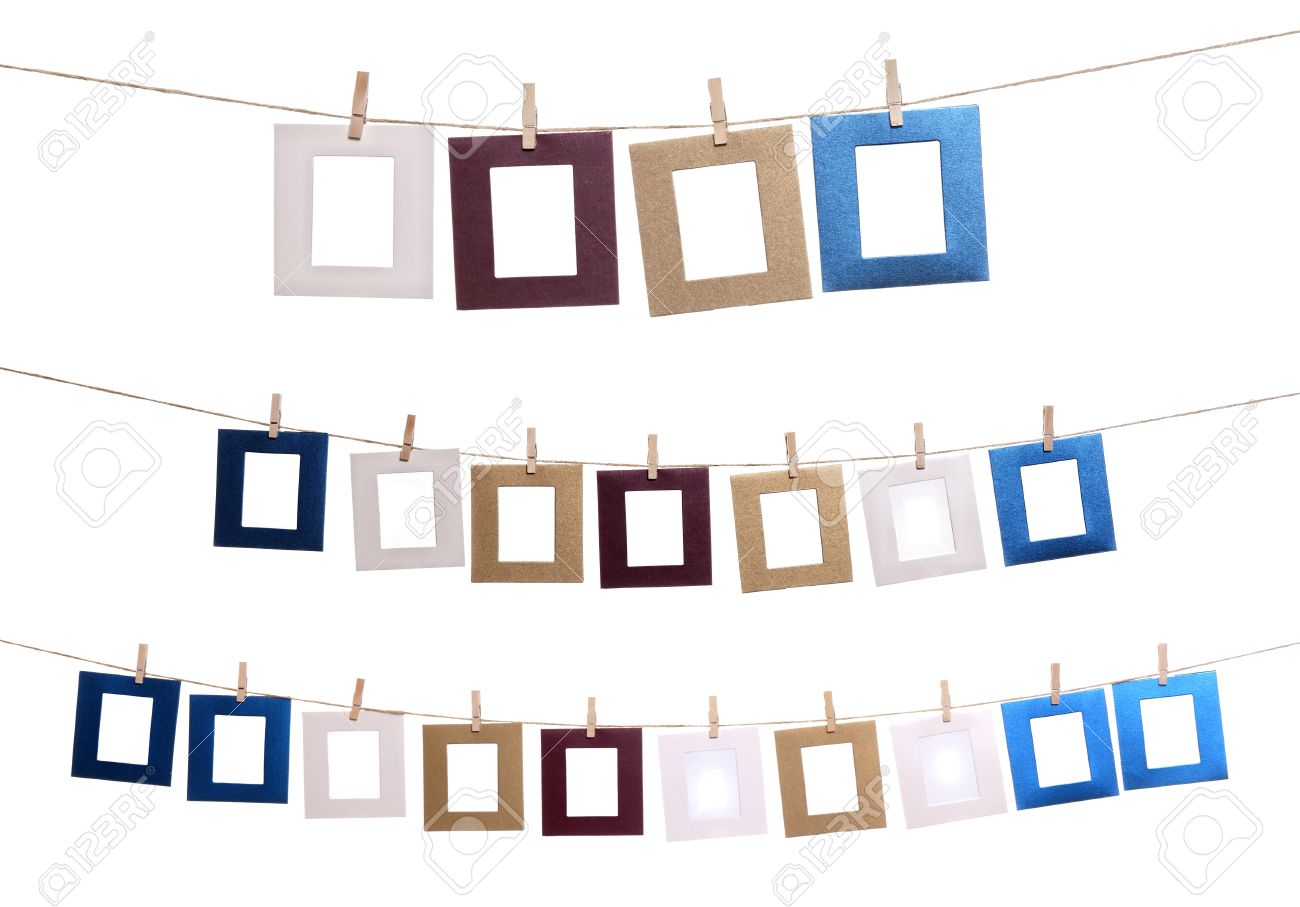 collection of blank photo frames hanging by clothespins on a rope stock photo 14774125