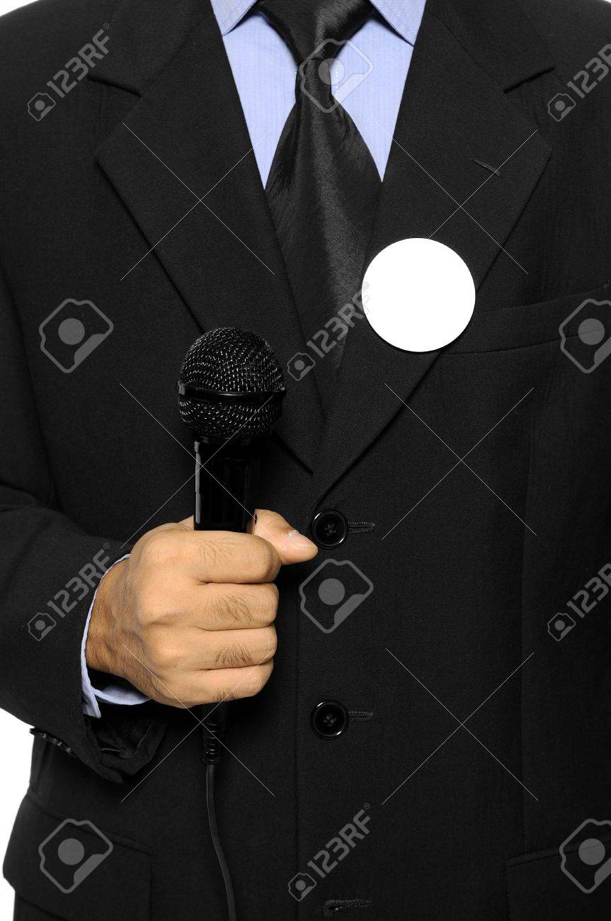 Man with black business suit with blank pinned button hold microphone  You can put your design on the button  Election day background or concept Stock Photo - 15717833