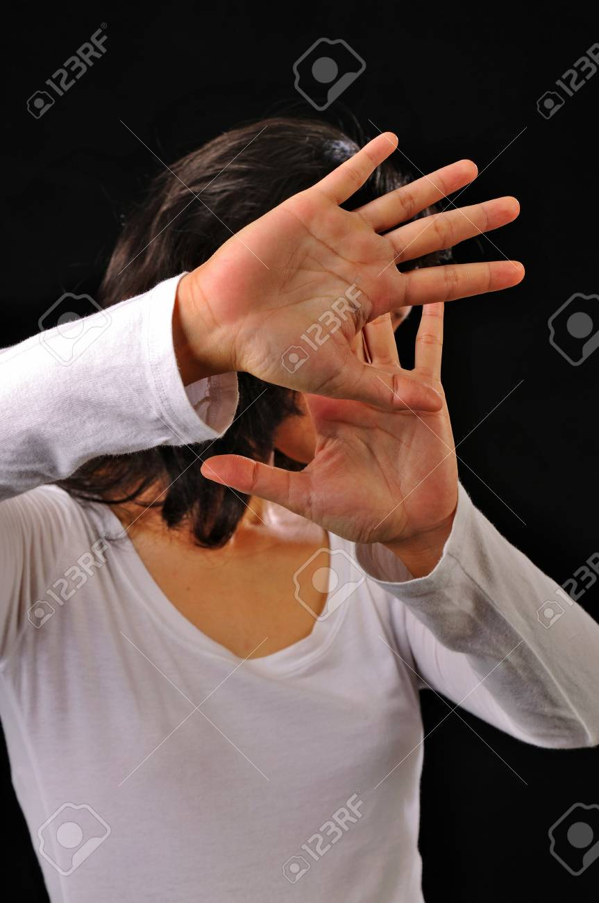 Portrait of asian woman cover her face isolated over black background Stock Photo - 18381387