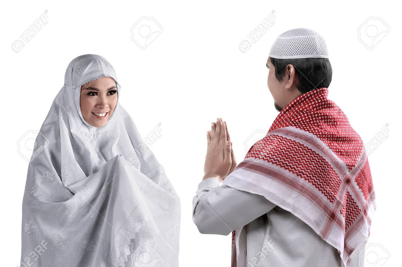 Asian Muslim Man And Woman Greet Each Other With Muslim Tradition
