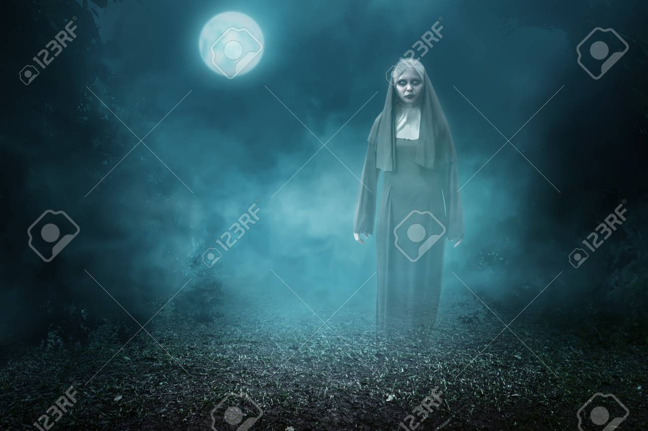 spirit nun asian woman haunting the forest at midnight stock photo