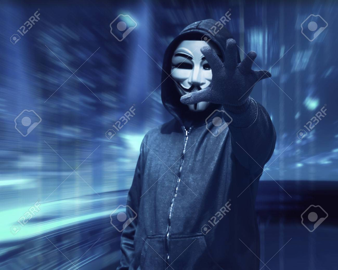 Hacker Man With Anonymous Mask Grabbing Something Over Visual