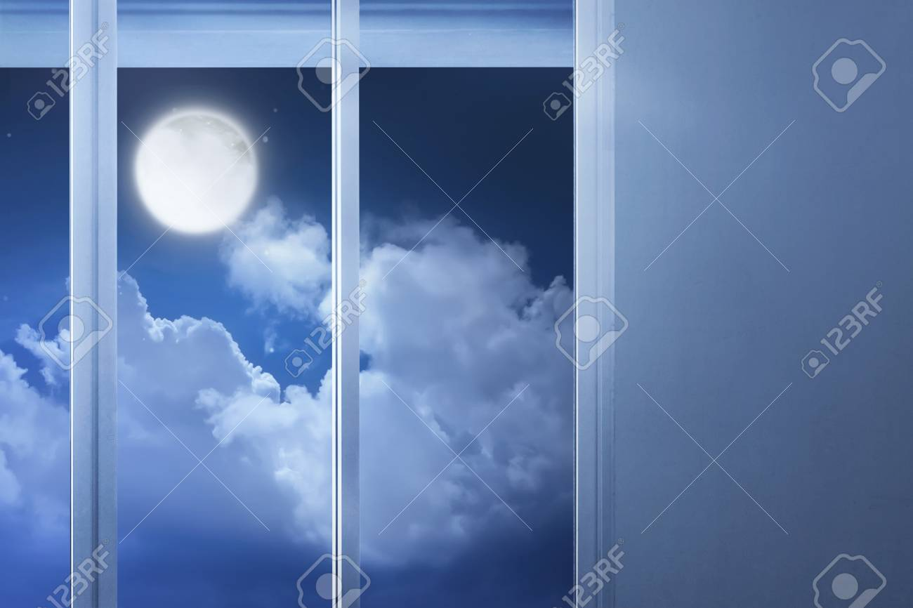 Window Glass In The Empty Room With Moonlight At Night Stock Photo