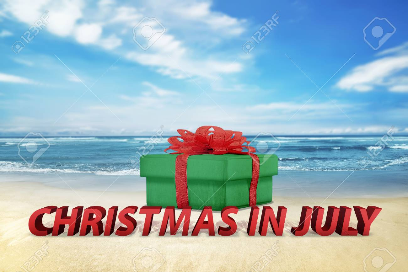 Christmas In July Background Images.Christmas Gift Box On The Beach With Ocean View Background