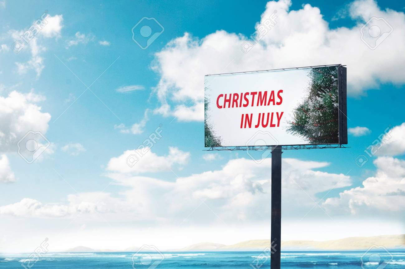 Christmas In July Background Images.Billboard With Text Christmas In July With Blue Sky Background