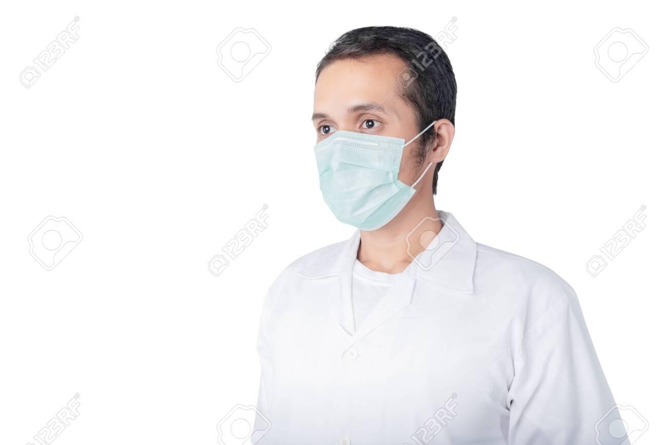 Asian man wearing a flu mask isolated over white background. Prevent flu disease Coronavirus - 142121296