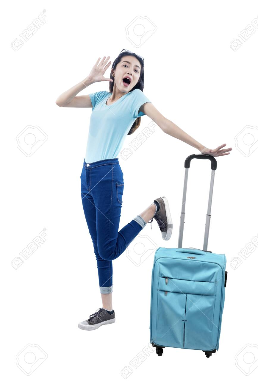 Asian woman standing with suitcase isolated over white background - 149909167