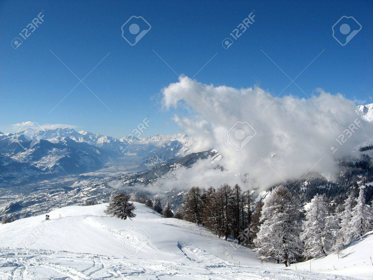 scenic view of ski slopes in resort of crans montana with mountains