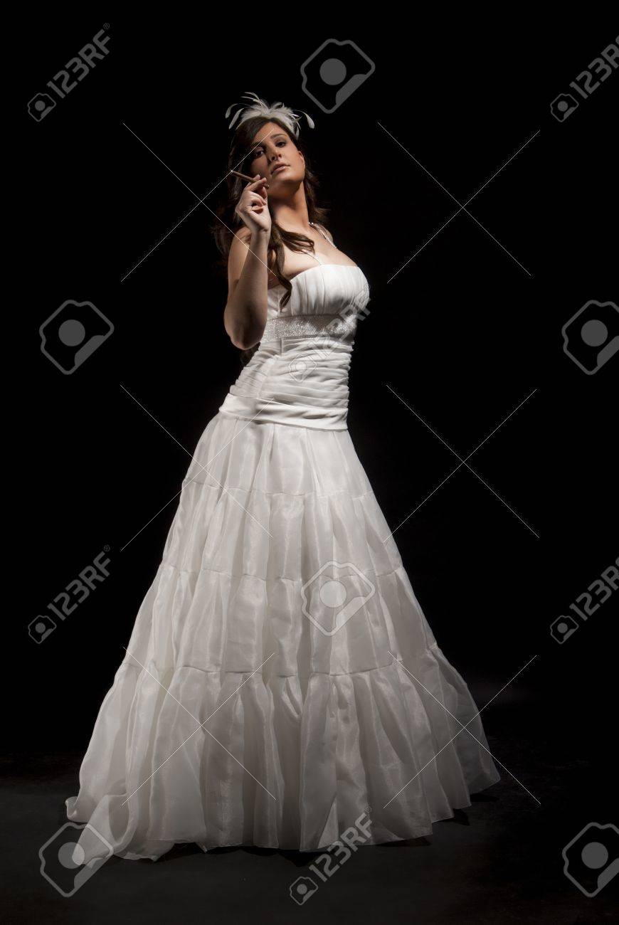 Isolated Bride On Black Background With White Dress Smoking A Cigar Stock Photo 20148338: Smoking Brides Wedding Dress At Websimilar.org
