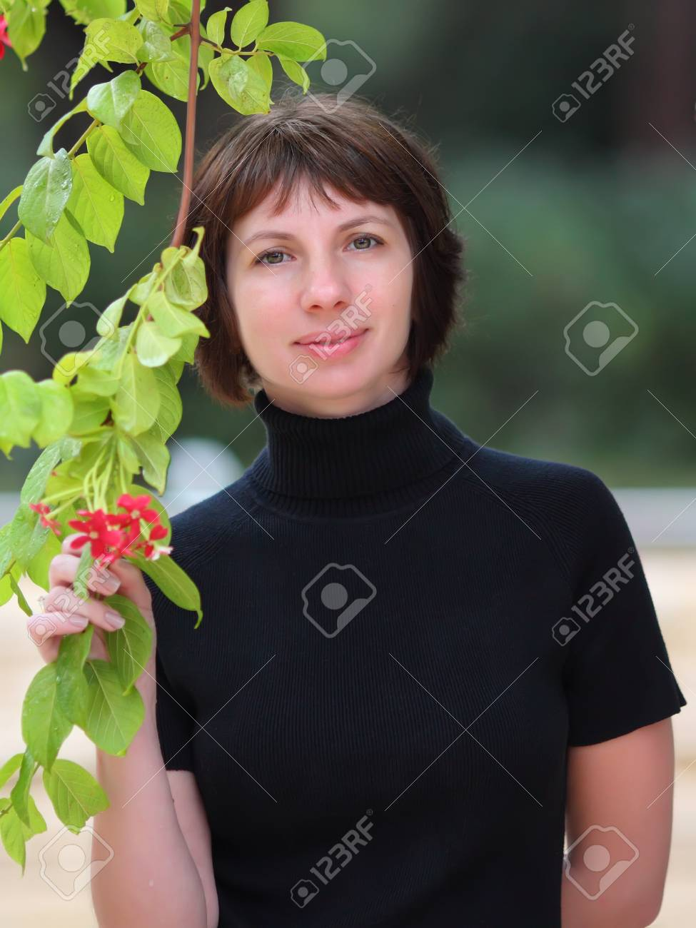 Portrait of a beautiful young woman posing near a tree Stock Photo - 16336375
