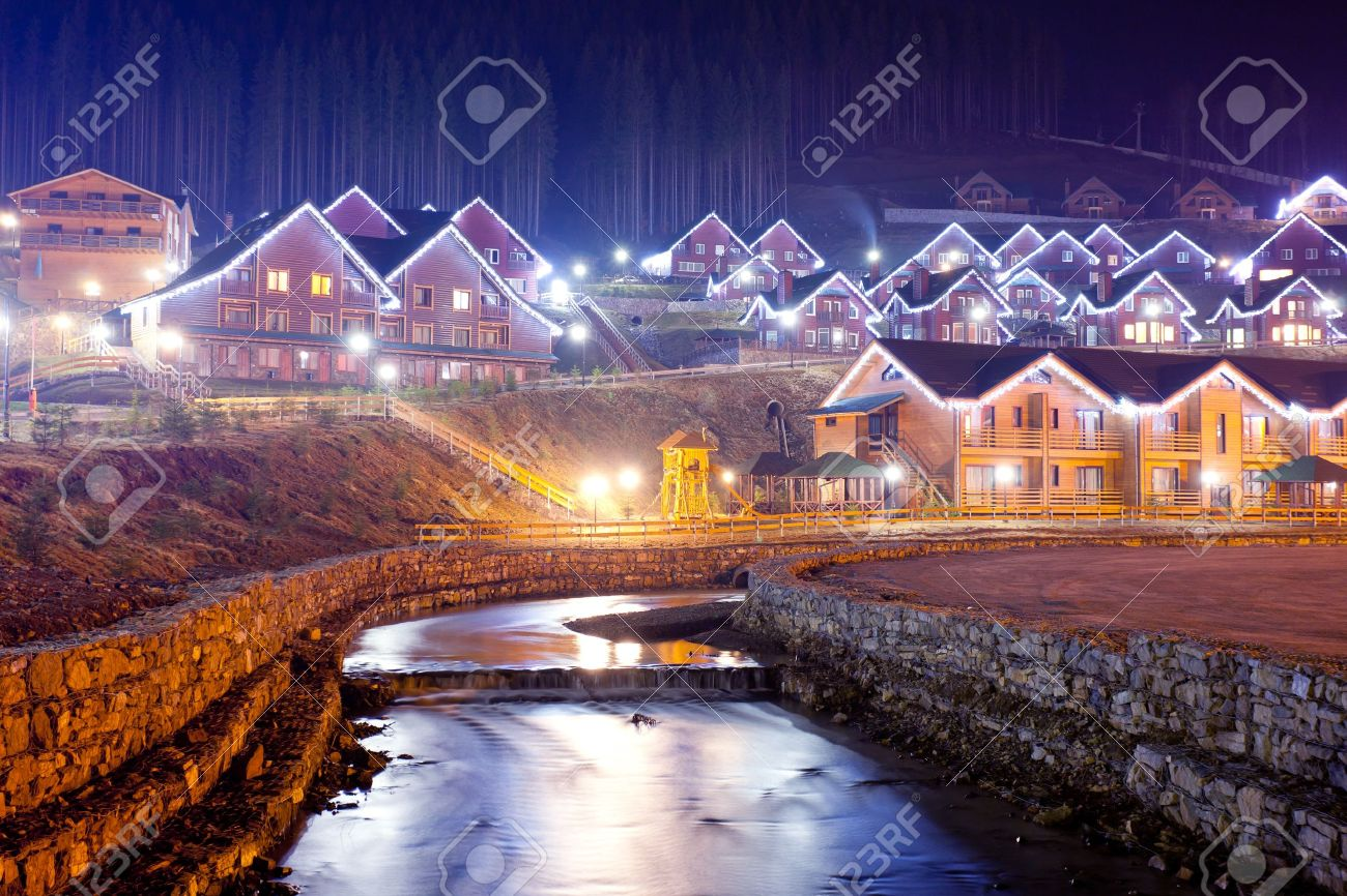 Christmas decorated houses - Houses Decorated And Lighted For Christmas At Night Stock Photo 16949656