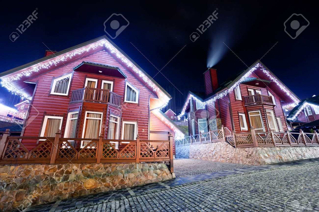 Houses decorated and lighted for christmas at night Stock Photo - 16949645