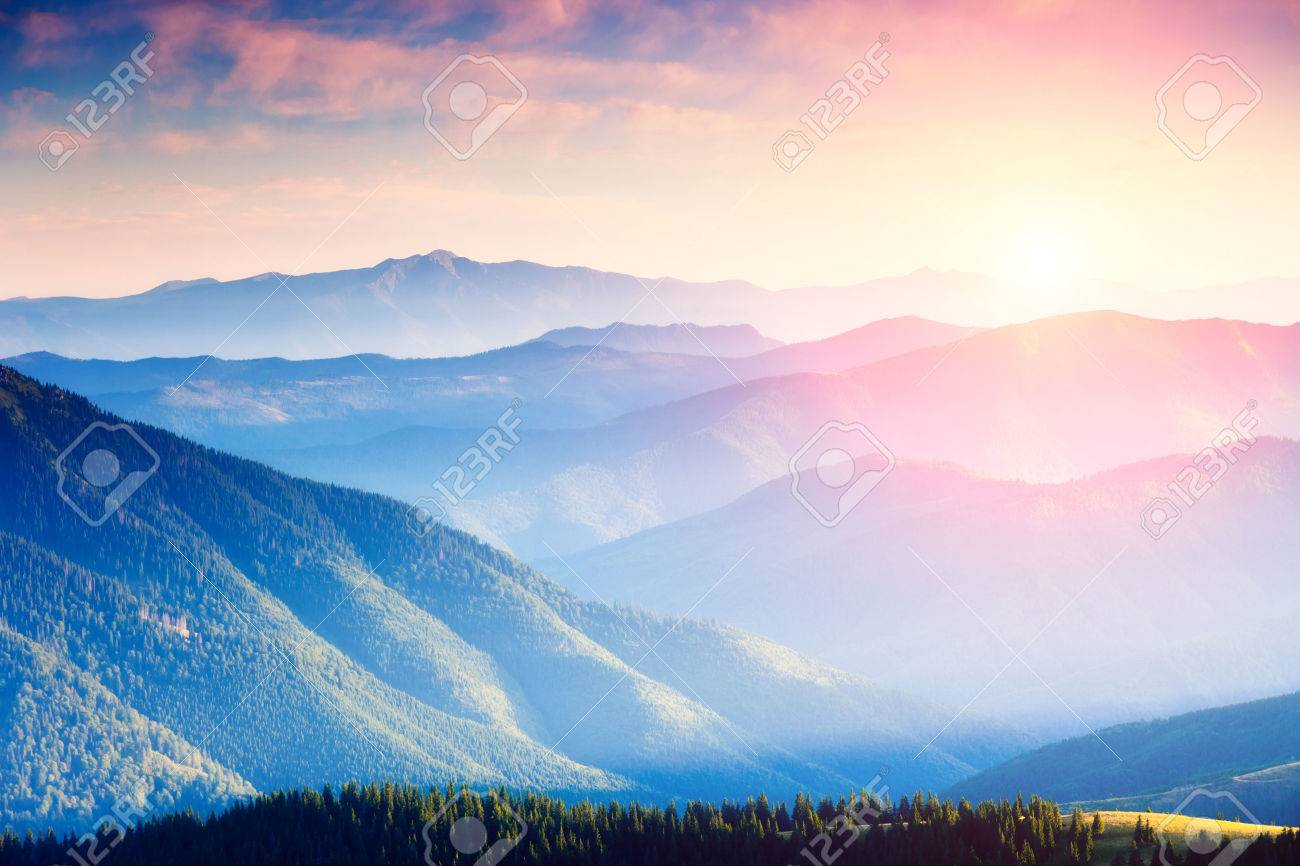 Majestic panorama of green mountains with sunny beams. Dramatic scene in National Park, Carpathian, Ukraine Stock Photo - 44978966
