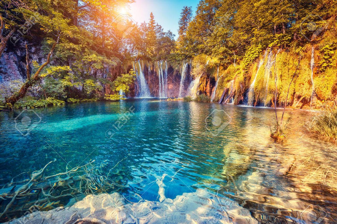 Majestic view on turquoise water and sunny beams in the Plitvice Lakes National Park, Croatia - 44978813