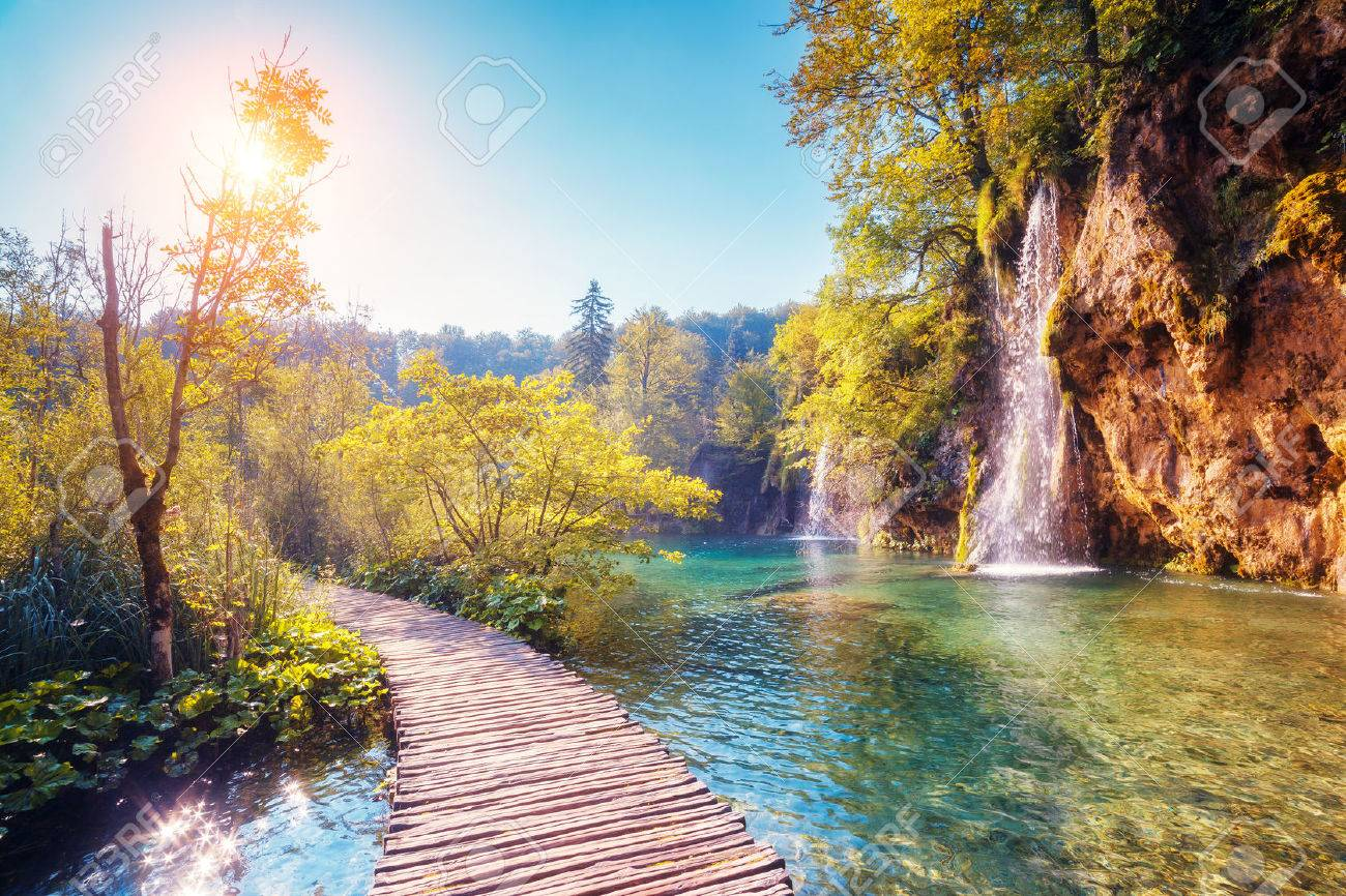 Majestic view on turquoise water and sunny beams in the Plitvice Lakes National Park, Croatia - 44978628